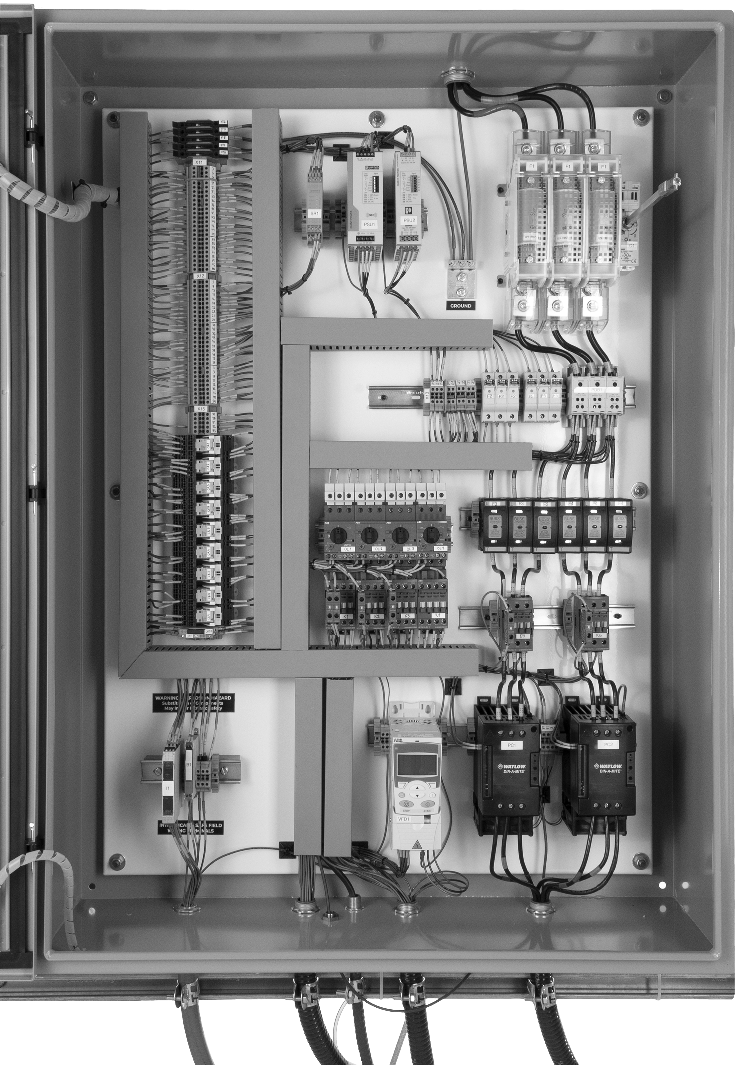 Internal view of a control panel showing the components and wiring
